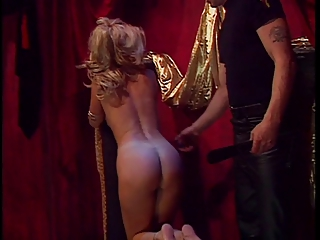 Busty blond restrained and has ass spanked