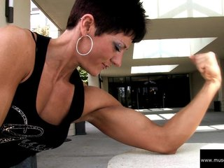 Allison Moyer Black Top Flexing Biceps